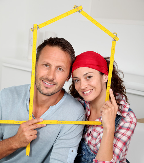 Couple looking through a house for a mortgage